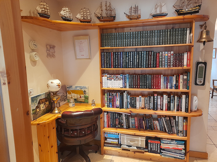 image showing mini library of Bushmills Thatched Cottage
