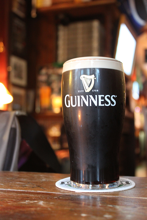 image showing a pint of guinness sitting on a bar